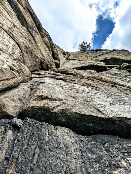 Short 2nd pitch of Standard Route.  Easy climbing up black streak then a couple of serious moves in well protected crack before you gain the ledge and next set of bolted anchors.  If continuing up standard route, do not use those anchors look up and left