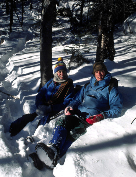 Mary Erdei and Ken SIms enjoying the warm afternoon sun while pausing in the 'rut' while descending from the 'Dike' in March 1980