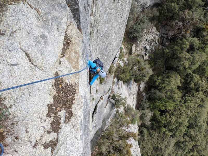 nearing P2 top, brief rest after 5.10+ face before 5.10+ finger crack if on original start