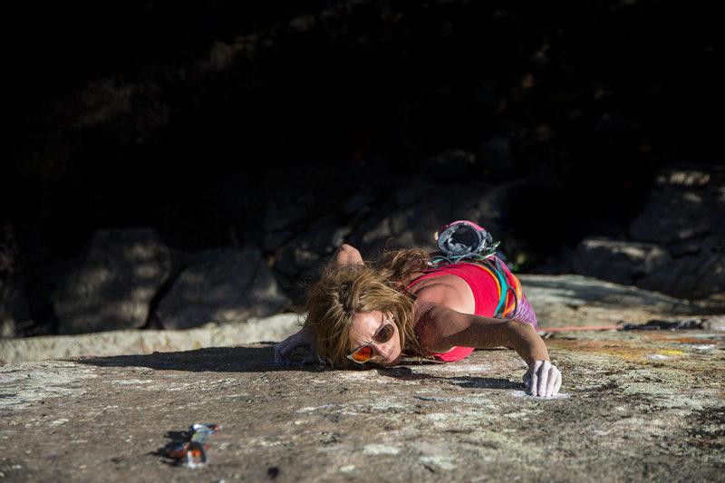 Heather Weidner entering the crux.<br> <br> Jon Glassberg photo.