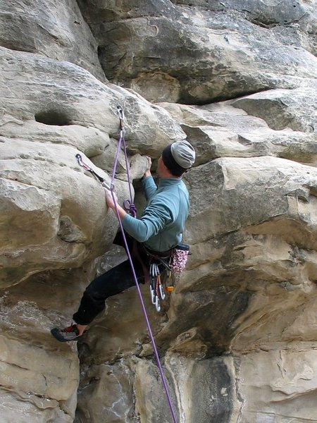 Matt grappling with the start of the unknown route left of Broken - 09 Nov 2003