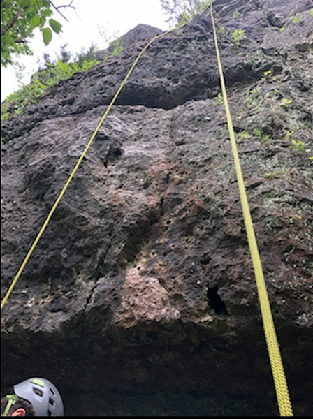 Start on the lighter colored rock. Rest of the route follows the left side of the rope in the picture.