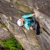 Anna Marie getting ready to move back right above the bolt and into the crux