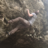 Sticking the hardest move on the boulder and not sending.