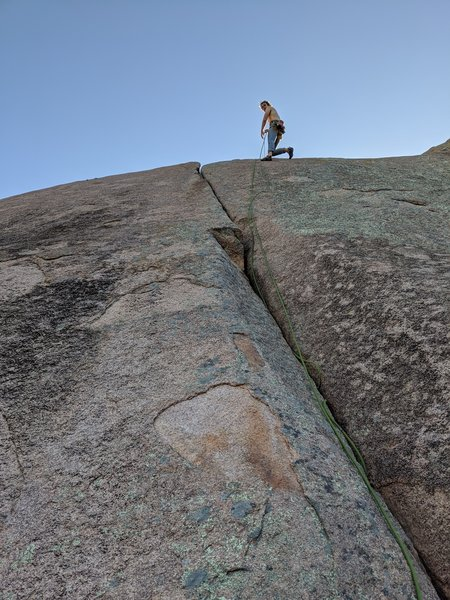 The anchor on the route to the right can easily be used to toperope Kryptonite. I used a #2 to help redirect the climber strand as the anchors are about 5-6 ft to the right of the top of the crack.