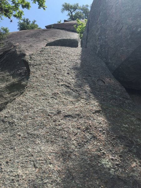 Starting slab boulder with undercling in view higher up