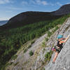 """Megan Clarke on the sharp end of """"Working Vacation 5.10b"""" at The Sunwall in the Humber Valley"""