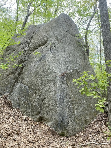 I found this boulder out on the Long Trail. It's incorporated into a stone wall, about 20 feet high, you can't miss it. There were TR bolts up top. I'm considering adding it as an area if it doesn't already have a name/established routes.