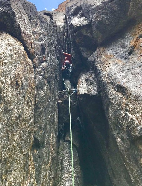 Tyler taking a last rest before heading up the squeeze chimney and offwidth.<br> <br> Photo by Mike Schneiter.