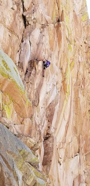 Will Buttierrez in the crux of the upper headwall.The whitish crack the curves left is what Gerrod followed to into Direct North Face corner which he climbed to the fat part, then he climbed the short thin vertical crack until possible to traverse right.