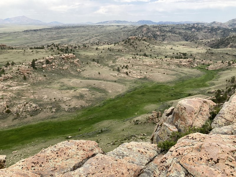 Break Up Rocks sit on the conelike mound in the upper just right of center