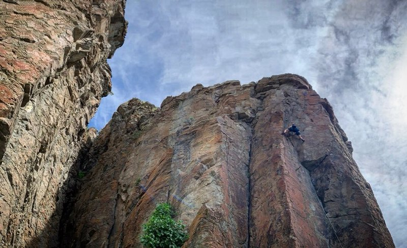 Chase working the crux up to the anchor