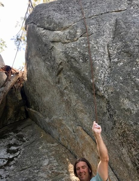 Climb starts at the rope on the right and angles to finish where the rope on the left hangs