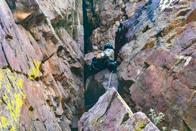 going up the first pitch. once reaching the ledge, go up and left to the bolted anchor for Vertical Addiction. If you're doing this, make sure to extend your last two pieces when you exit the tunnel and turn left, because it is a ways left.