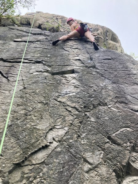 A climber after the crux on Quickstep when it meets with Hair Line.