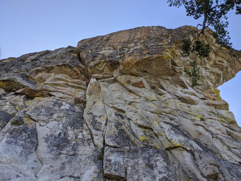 The left side of the buttress, hosting a protectable crack and an 11b bolted line up the face