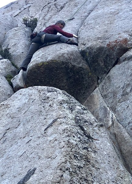 Michelle Kelley at what we thought was the crux move, stepping over the 1st bolt above the roof over to the seam.