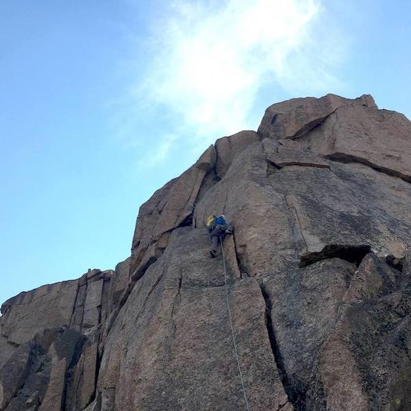 The final real pitch. Cracks and face lead up to the obvious break near the top, which could be climbed directly at 5.9/5.10. We hand-traversed around to the right to exit, which was fun.<br> <br> Photo by Kelly Cordes.