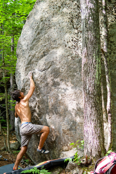 Dominic figuring out the beta sequence for the boulder.