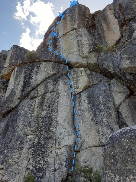 Route follows the obvious crack down low, then steps slightly left up high.
