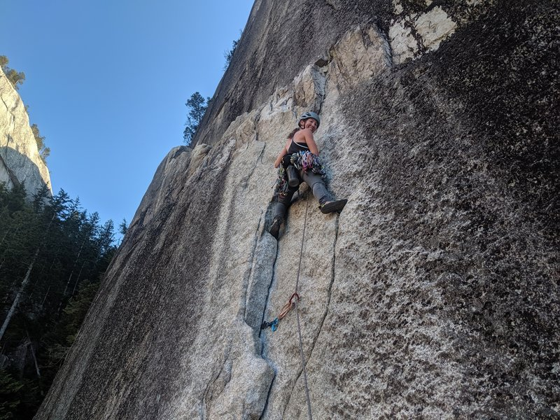Michelle at the start of the pitch. she traversed that ledge past the first set of anchors to the second by a tree