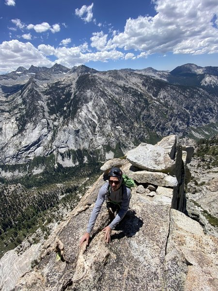 Topping out on the South Face. Go around the westside of the summit block and down it's backside to descend.