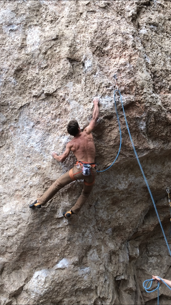 French American Climber Camille sticking the hardest move of the route which just so happens to be right off the ground!