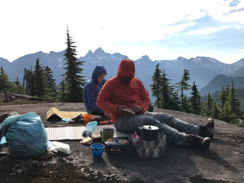 Camp on the rock slabs where the trail breaks into the alpine is excellent.