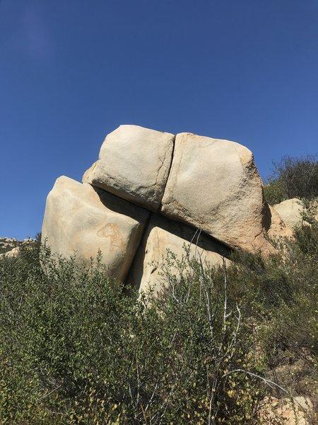 An interesting boulder. Cootie Catcher runs up the main line.