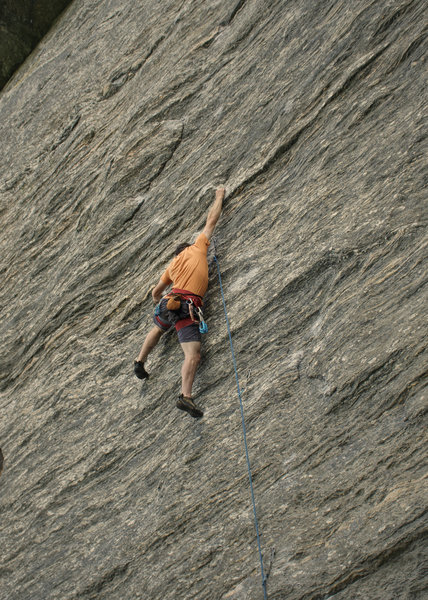 climber working the route