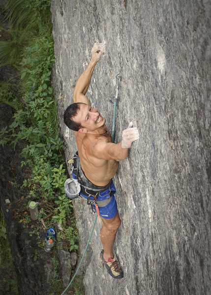 climber moving past second bolt