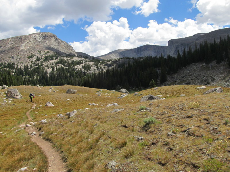 Spectator Buttress is above the hiker, on the left as you enter the Lost Twin Lakes cirque.