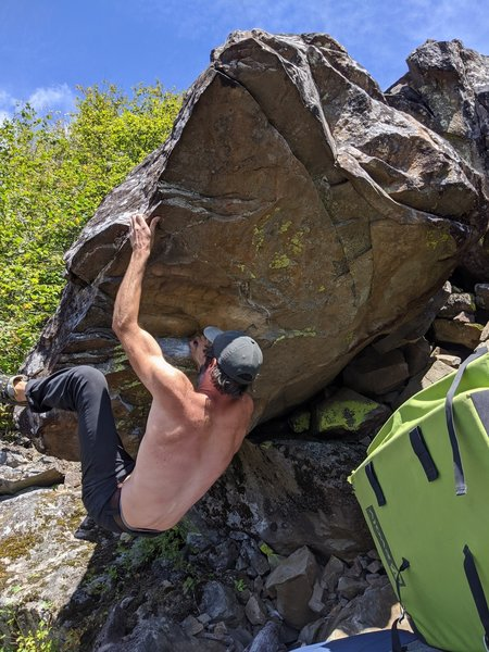 Solid small roof boulder! Good holds, bouncy moves! Wish it was longer though. Could have a fun shorter variations starting from the large roof flake (V3/4?). Bummer about the name though.