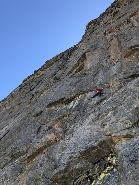 P9 climbing off of Der Major. The optional belay is down and to the right at the base of the large corner.