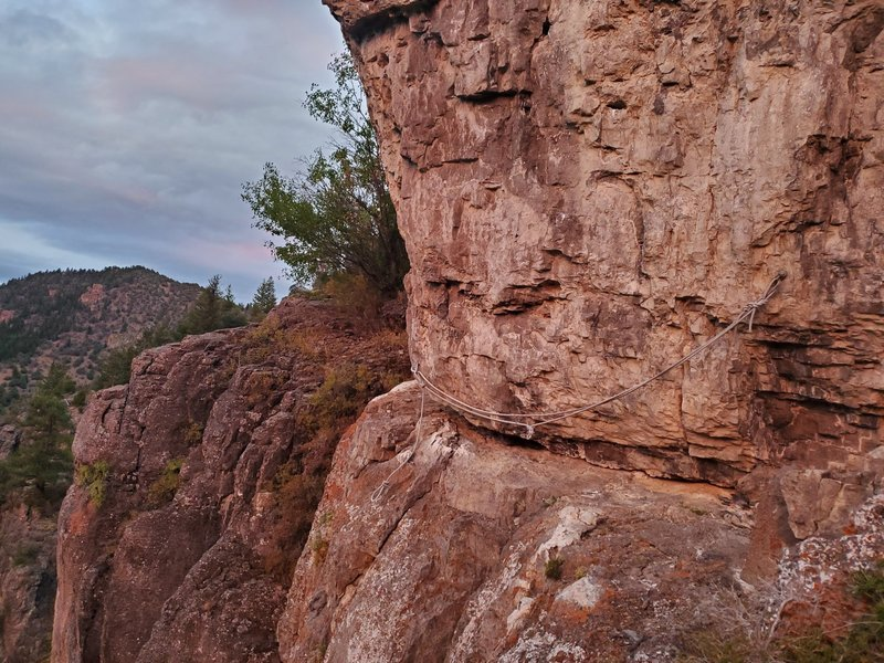 Traverse around the arete. The rope currently is too worn to trust with a massive coreshot