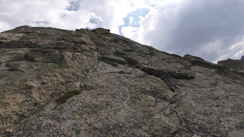 Isolation Peak crux. Mid 5th straight up. After about 100', trend left to pick up 4th Class and on to the summit - eventually.