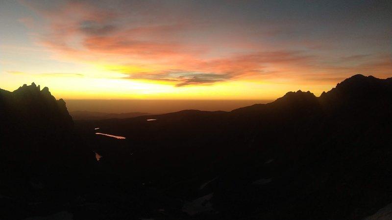 Sunrise over Boulder from a bivy on the Kasparov Traverse.