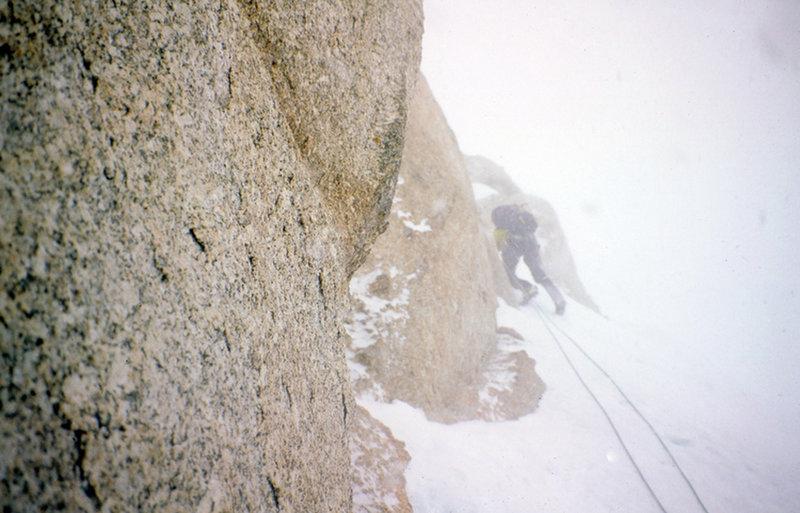 Climbing steepish ice in a storm thru a rock band aprox 15k on west rib