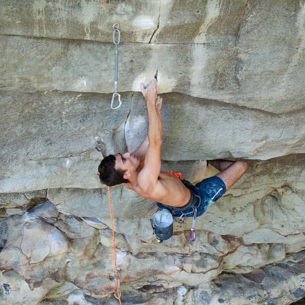 Chris Tabeling focusing on perfect hand placements in the fingerlock crux of Twilight (13c).<br> <br> Climber: @racing_table<br> Photo: @dirtysouthclimber