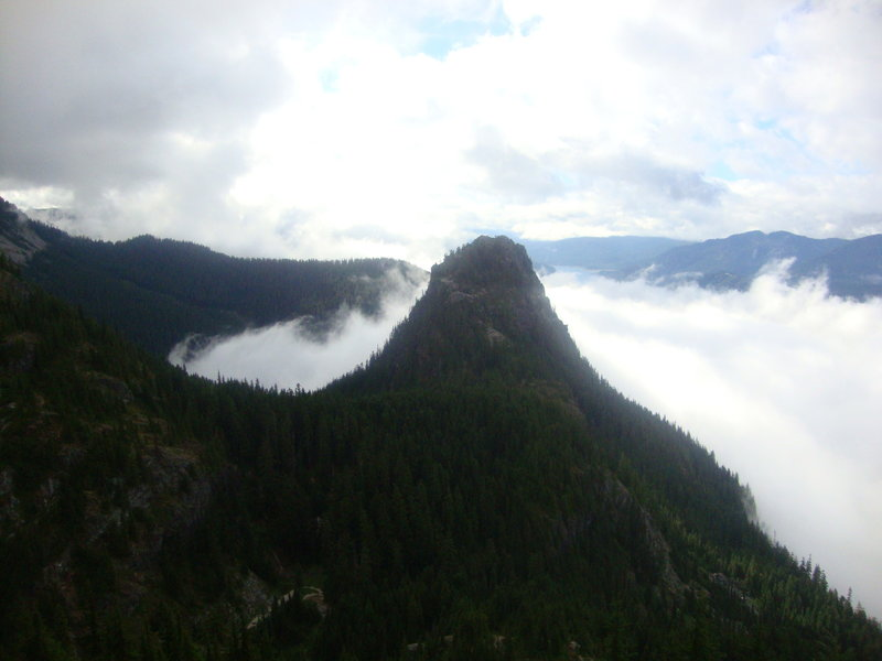 Pass area filled with clouds, Guye towering overhead. From Snoqualmie south shoulder.