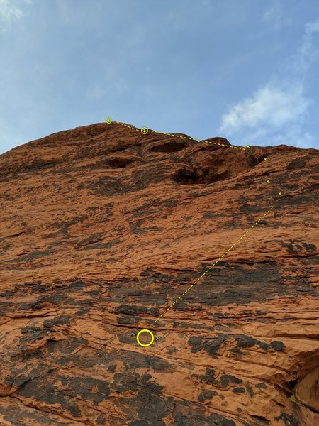 Bewitched first pitch (5.5). A set of hangers can be seen to anchor the belayer if you want.