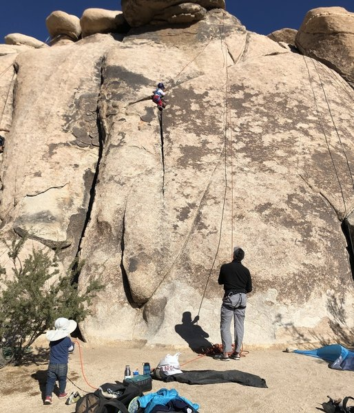 This route makes for a good beginner toprope for kids.  My 4 year-old daughter is having fun climbing the crack. She started near where my shadow is.