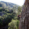 Bryson Fienup climbs with the namesake tourists watching from the trail below (Tourist Trap, Pinnacles National Park)
