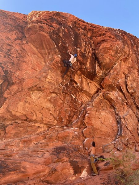 Ethan on his send of Sweet Pain, with Alex on the belay.