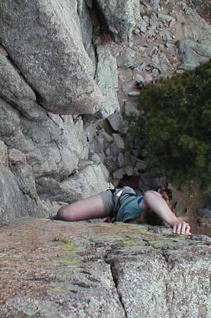 A lady climbing.