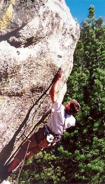 Pete Franzen on the crux final move of Dyno Monkey