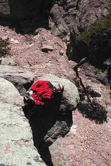 Kurt Komarnitsky catches some rays on the belay ledge for pitch number 2.