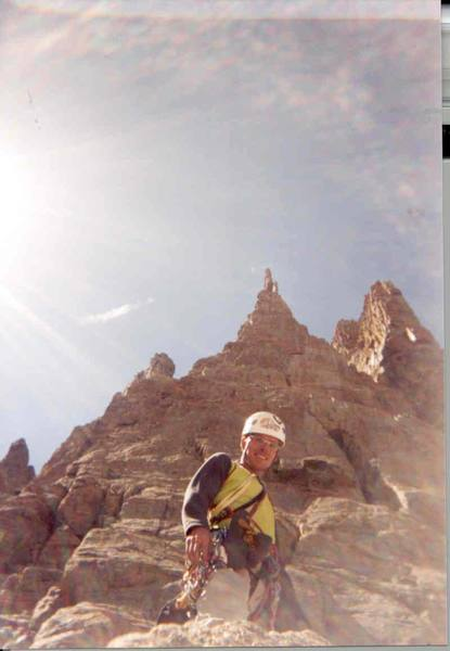 Chris Fisher, big smiles after a successful summit of Petit Grepon by way of the South Face.