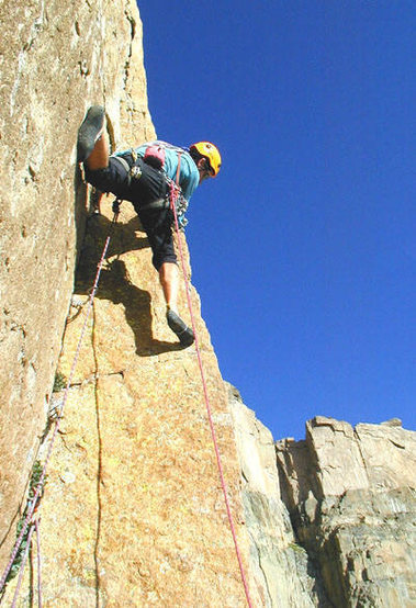 Climber: Tom Kimbrell, on the first 5.11 pitch of Yellow Wall.<br> <br> Photographer: Bob Rotert.