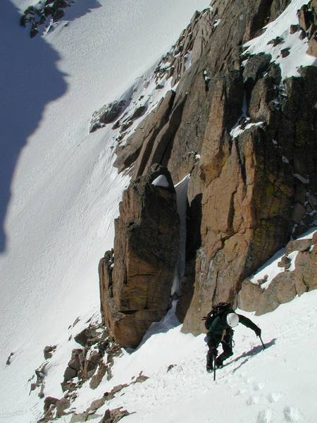 Rodger Poage on the exposed traverse onto Broadway from Lamb's Slide, May 2000.  Photographer:  Paul Crowder.